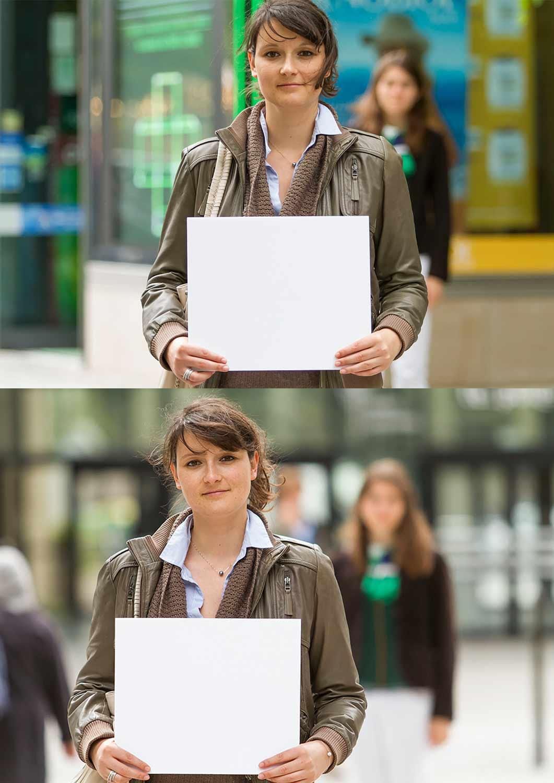 Jeune femme tient une pancarte dans la rue